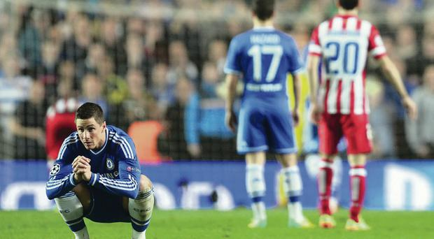 Fernando Torres looks away as Diego Costa takes his penalty