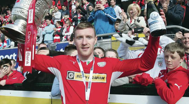 Deserved: Chris Curran lifts the Gibson Cup