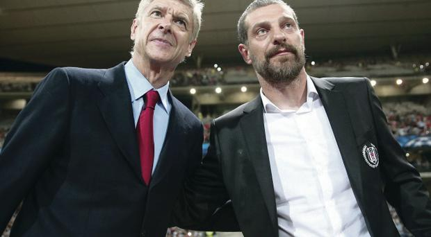 Best of enemies: Arsene Wenger and Slaven Bilic after the match