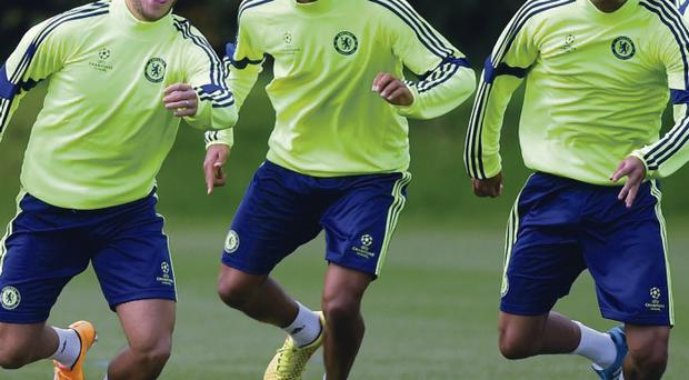 Ready to rock: Chelsea's Eden Hazard, Nathan Ake and Lewis Baker go through their paces at yesterday's training session at Cobham