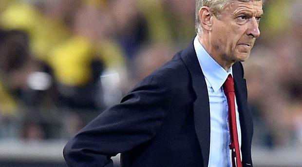 Arsenal manager Arsene Wenger looks on as his side are beaten last night