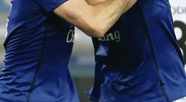 Lip service: Leighton Baines gets a kiss from Seamus Coleman
