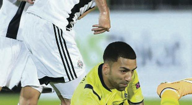 Up and down: Aaron Lennon of Spurs is fouled by Nikola Drincic