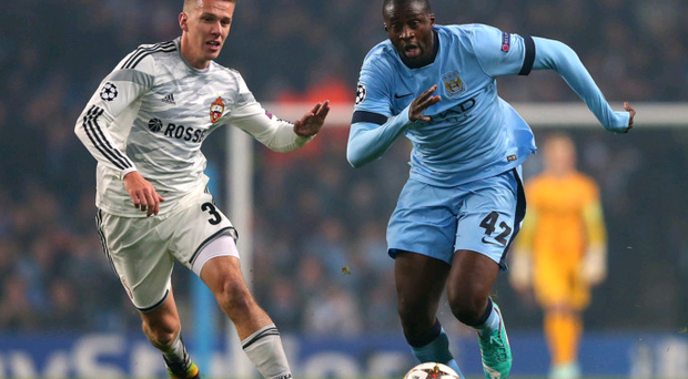 Chase is on: Yaya Toure competes with Pontus Wenbloom of CSKA Moscow. The City midfielder was later shown a red card