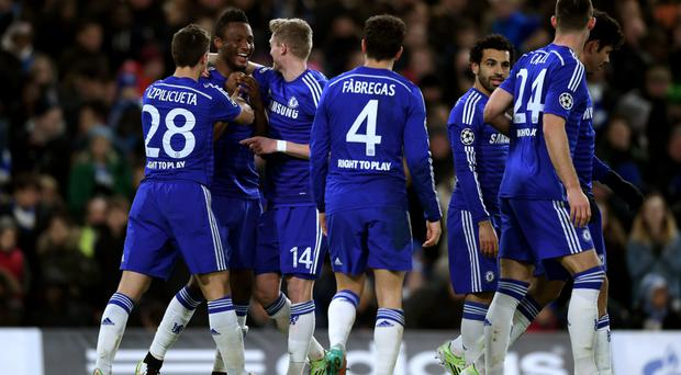On target: John Obi Mikel takes the congratulations after scoring Chelsea's third goal last night against Sporting