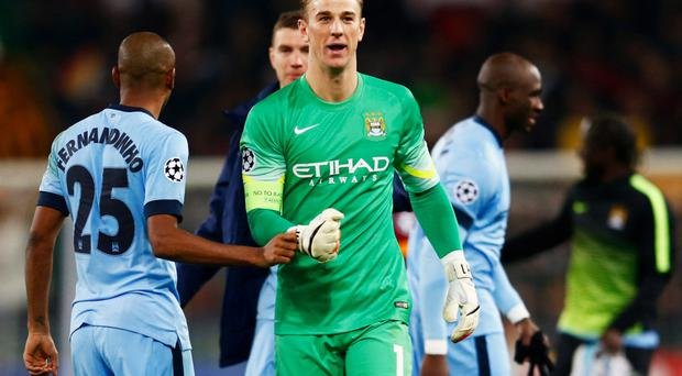 Job well done: Joe Hart shows his delight at the end of the game as Manchester City make it through to the last 16