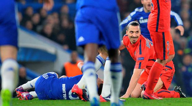 Off you go: Zlatan Ibrahimovic after flooring Chelsea's Oscar