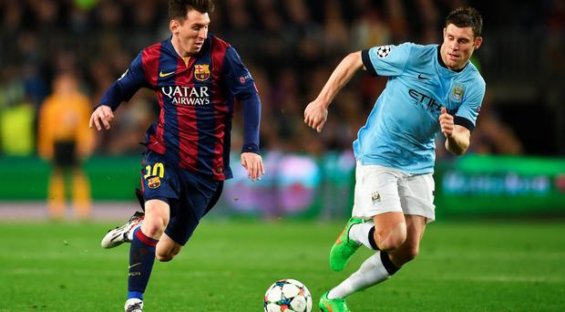 Try stopping him: Barca's Lionel Messi takes on James Milner of Manchester City during last night's Champions League game