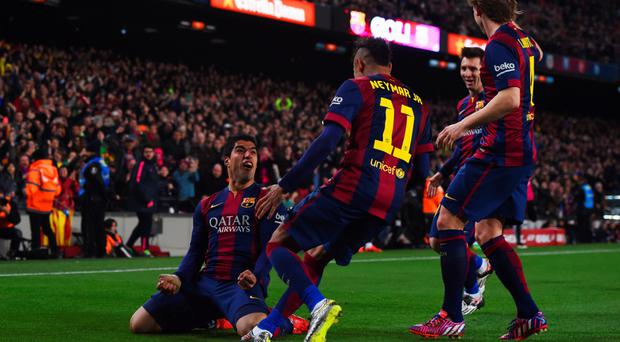 Sheer delight: Luis Suarez is congratulated at the Nou Camp