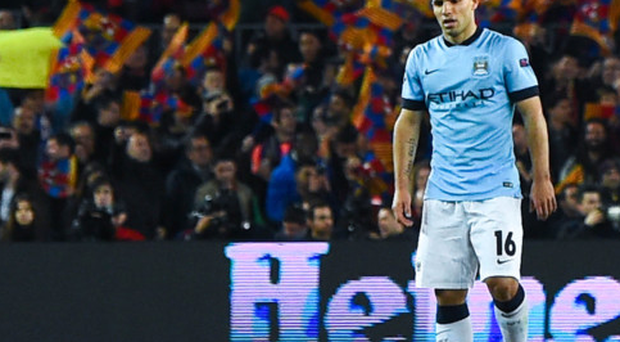 Pain game: Manchester City's Sergio Aguero had the misfortune of coming up against Barcelona in the Champions League