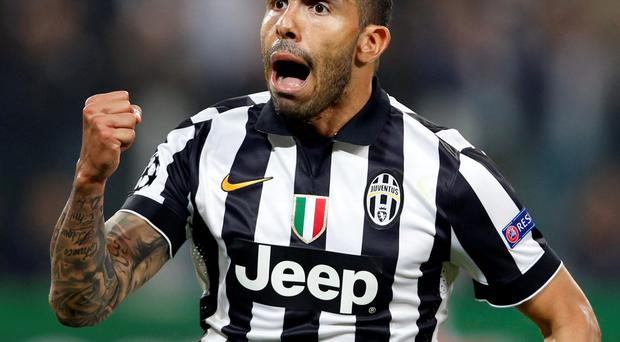 Crucial goal: Carlos Tevez enjoys the moment after making it 2-1 to Juventus in the Champions League semi-final first leg against Real Madrid in Turin. The 2-1 scoreline gives the Italians a fighting chance going into next week's second leg at the Bernabeu