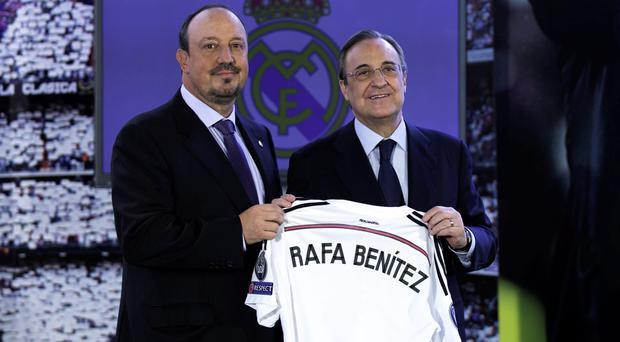 New Real Madrid head coach Rafael Benitez (left) poses for a picture with president Florentino Perez
