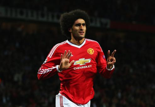 Marouane Fellaini of Manchester United celebrates scoring his team's third goal