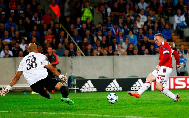 Treble yell: Wayne Rooney keeps cool to complete his hat-trick against Brugge