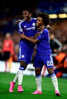 Chelsea's Willian (right) celebrates scoring his side's first goal with teammate Baba Rahman
