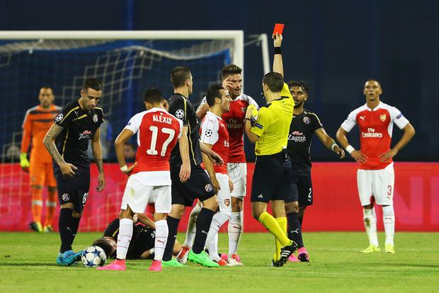 Red mist: Olivier Giroud is shown the red card by referee Ovidiu Hategan