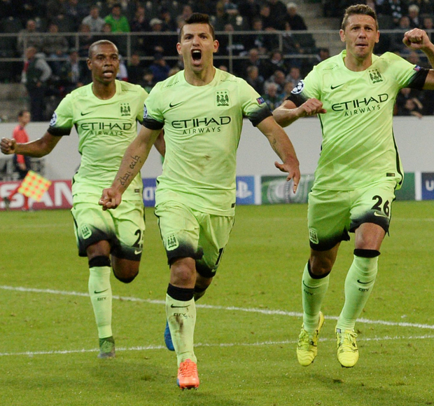 Late drama: Manchester City's Sergio Agüero, centre, celebrates his side's second goal