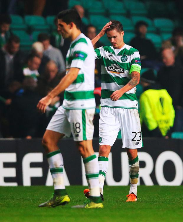 Rock bottom: A dejected Mikael Lustig walks off after defeat knowing Celtic face an uphill struggle to progress