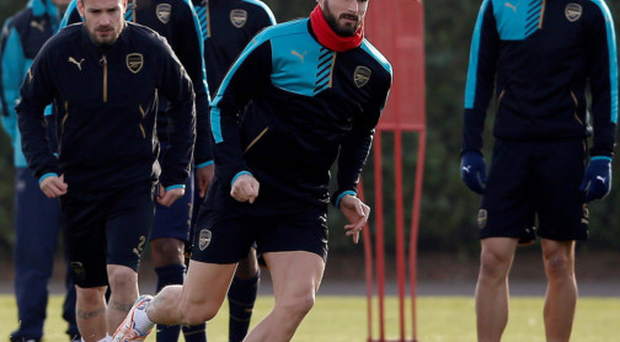 On the run: Olivier Giroud leads his Arsenal team mates in training ahead of their Champions League tie with Dynamo Zagreb