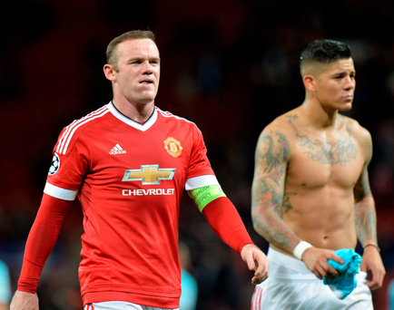 Poor show: Manchester United's Wayne Rooney and Marcos Rojo (right) reflect on a lacklustre display