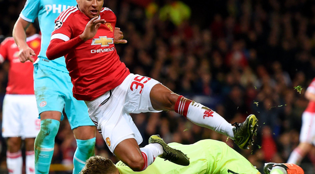 Drawing a blank: PSV Eindhoven goalkeeper Jeroen Zoet (left) saves at the feet of Manchester United's Jesse Lingard
