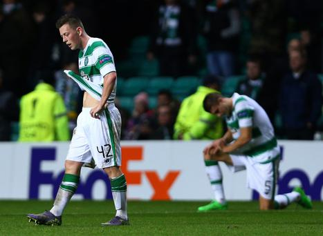 Down and out: Celtic goalscorer Callum McGregor looks dejected after his side were dumped out of the Europa League