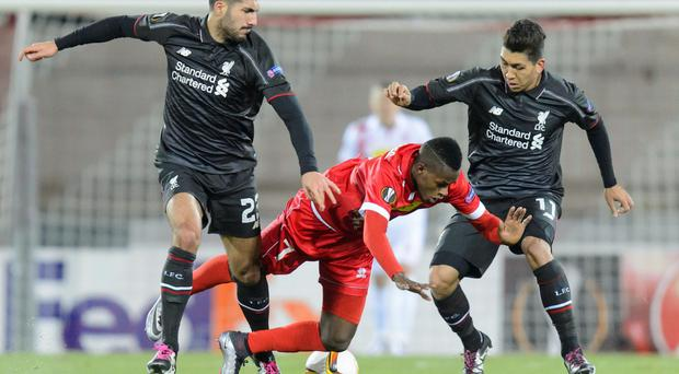 Grounds for concern: Liverpool aces Emre Can and Firmino take on FC Sion but boss Jurgen Klopp had concerns over the pitch