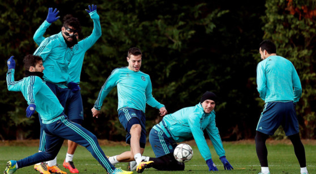 Gearing up: Cesc Fabregas attempts to tackle Cesar Azpilicueta as Chelsea train ahead of their Champions League clash with PSG