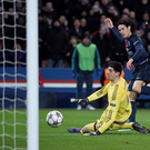 Back of the net: PSG substitute Edinson Cavani slots past Thibaut Courtois to seal a 2-1 win