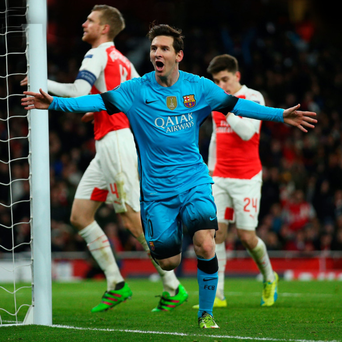 Goal king: Lionel Messi celebrates his opener against Arsenal last night