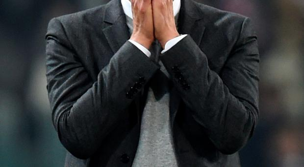 In disbelief: Pep Guardiola watches Bayern blow 2-0 lead