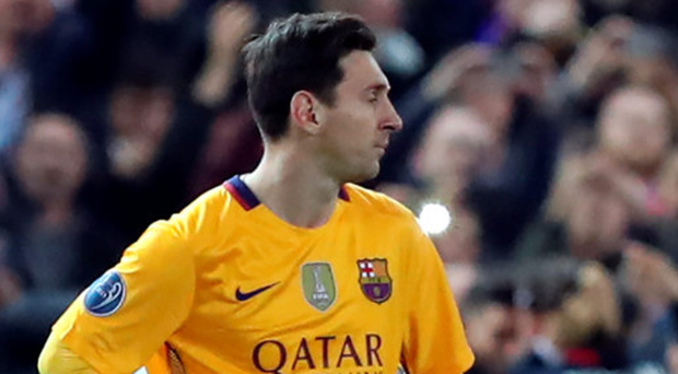 Down and out: Barcelona star Lionel Messi shows his dejection after Atletico Madrid's second goal