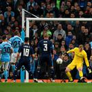 Top form: City keeper Joe Hart reacts to deny Sergio Ramos