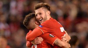 Final chapter: Adam Lallana and Philippe Coutinho celebrate victory
