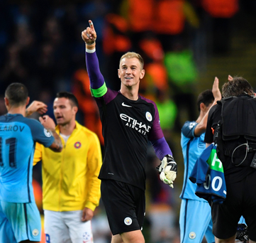 Final farewell? Joe Hart salutes the crowd as Manchester City celebrate progress to the Champions League group stages with victory over Steaua Bucharest