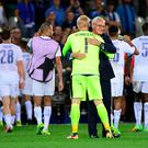 Claudio Ranieri celebrates with goalkeeper Kasper Schmeichel following Leicester's victory over Brugge