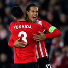 Victory roar: Virgil van Dijk celebrates with Maya Yoshida