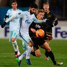 Jostle: Zenit defender Luis Neto and Dundalk's David McMillan vie for the ball at the Petrovsky Stadium