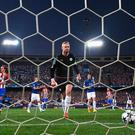 Penalty pain: Kasper Schmeichel retrieves the ball from his net