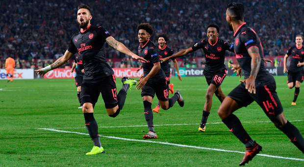 Over the moon: Arsenal celebrate after Olivier Giroud's (left) late winner in Belgrade