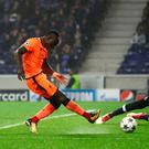 Top finisher: Sadio Mane scores his second goal and Liverpool's third at Estadio do Dragao last night