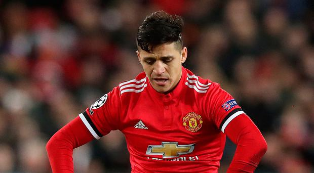 Down and out: Alexis Sanchez shows his frustration