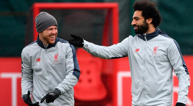 Relaxed mood: Liverpool's Alberto Moreno (left) and Mohamed Salah during training