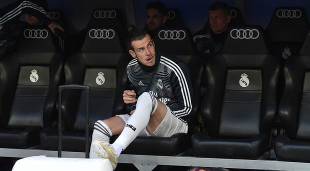 Going nowhere: Gareth Bale is now set to stay put at the Bernabeu