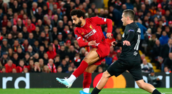 Guiding light: Mohamed Salah fires home his first of the night for Liverpool