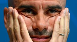 Tough road: Pep Guardiola has yet to see his Manchester City side set Europe alight
