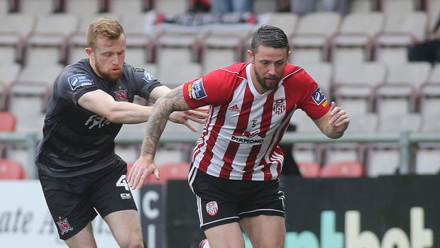 Breaking clear: Derry ace Rory Patterson gets away from Sean Hoare of Dundalk at the Brandywell