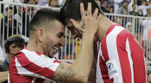 Atletico Madrid staged a late comeback to stun Barcelona in the Spanish Super Cup semi-finals (Hassan Ammar/AP)