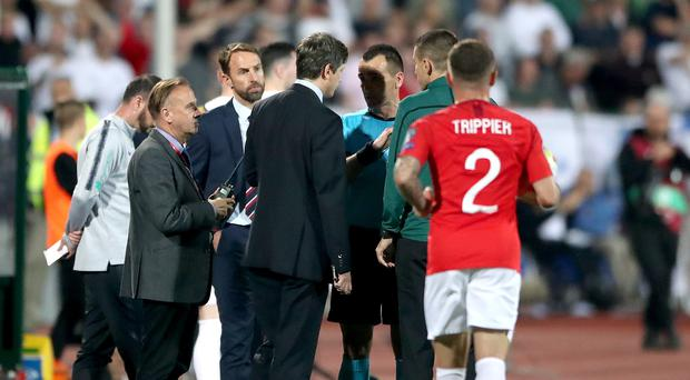 England manager Gareth Southgate, second left, speaks to Croatian referee Ivan Bebek during the Euro 2020 qualifier against Bulgaria in Sofia