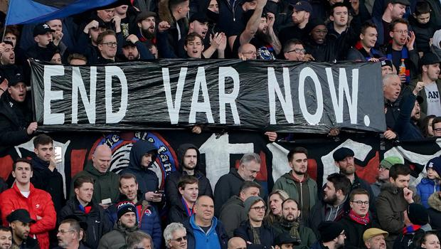 Supporters at a Crystal Palace v Arsenal match hold up an anti-VAR banner (Tess Derry/PA)